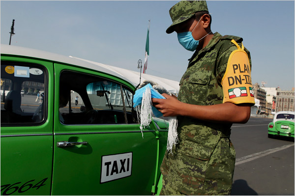 Soldier distributes masks in Mexico City