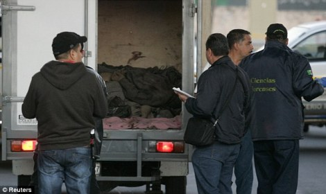 Photo Credit: Daily Mail. Mexican police discover 26 bodies in vans and trucks in Guadalajara, Mexico.