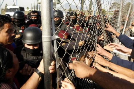 Security forces hold back the family members of prisoners at the Apodaca penitentiary in Nuevo León after a riot killed 44 inmates on February 19. Photo Credit: Getty Images