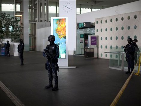 Police guard the Mexico City International Airport following the killing of three police officers there on Monday. Photo: Associated Press