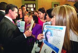Family members greet President Peña Nieto in Los Pinos with information about their missing or deceased loved ones on the day he signed the General Victim's Law. Photo: La Crónica de Hoy