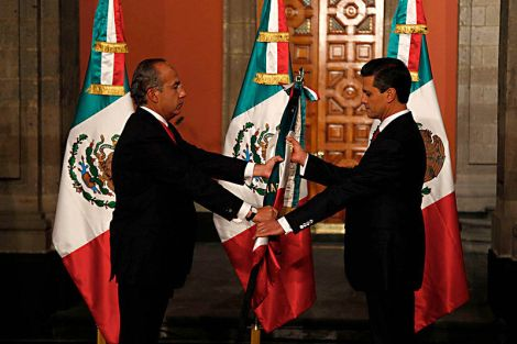 President Enrique Peña Nieto (right) takes office in December 2012 from former President Felipe Calderón (left). Photo: Wikimedia Commons